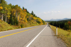 Roadside mountains and forests. Autumn scenic view of rocky mountains, forests and road (highway 40) while traveling in kananaskis country, alberta, canada Stock Photo
