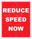 "Reduce speed now. Roadside notice with text ""reduce speed now"" in uppercase white letters on a grunge red background. A way to reduce accidents Royalty Free Stock Image"