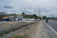 Roadside of Palu after tsunami full of refugee royalty free stock photo
