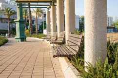 Roadside patio of columns and benches Stock Image