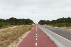 Roadside Red cycle path Royalty Free Stock Image