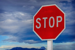 Roadside red stop sign on a cloudy background. Royalty Free Stock Photo