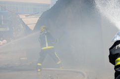 Roadside restaurant fire site. Roadside restaurant reason the use of circuit, fire, smoke a big scene, almost burned everything inside, firefighters fighting Stock Images