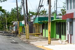 Hurricane Maria Damage in Puerto Rico. Roadside scene in Rincon, Puerto Rico after Hurricane Marie showing damage to businesses and power lines Royalty Free Stock Photo