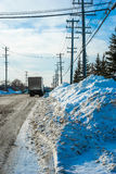 Roadside after snow clearing Stock Image