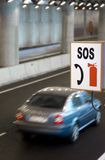Roadside SOS Sign. In a Highway Tunnel Royalty Free Stock Photo