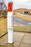 Roadside SOS Telephone. SOS Telephone on a Mountain Road in Scotland stock images