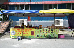 Roadside stall selling maltose candy biscuit at Tualang in Malay. TUALANG, MALAYSIA-28 DECEMBER, 2016: Roadside stall selling maltose candy biscuit at Tualang in Royalty Free Stock Photography