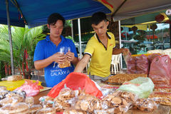 Roadside stall selling maltose candy biscuit at Tualang in Malay. TUALANG, MALAYSIA-28 DECEMBER, 2016: Roadside stall selling maltose candy biscuit at Tualang in Royalty Free Stock Photo