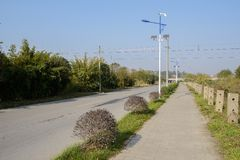 Roadside streetlamps with wind-driven generator and solar cells. In sunny winter,Chengdu,China royalty free stock image