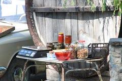 Roadside trade in Crimea nuts, adjika, mushrooms Royalty Free Stock Photo