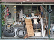 A Roadside Used Items Yard Sale. A mixed collection of used household items for sale displayed on a rural roadside porch Stock Photography