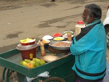 Odaikanal, Tamil Nadu, India - June 11, 2010 A roadside vendor selling fruits and snacks. A roadside vendor, stall selling fruits, mangoes, peanuts and other Royalty Free Stock Photography