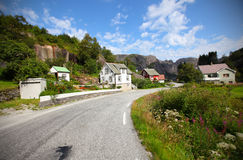 Roadside village with wooden houses in Scandinavia Royalty Free Stock Images