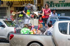 Roadside warfare. Bangkok, Thailand, 14 April 2015. Groups of festival goers celebrate Songkran by tossing buckets of water on each other while riding on the Royalty Free Stock Photo