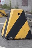 Roadside warning sign / warning stump. Traffic warning apparatus painted with black & yellow stripes Royalty Free Stock Photography