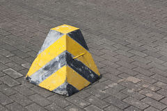 Roadside warning sign / warning stump. Traffic warning apparatus painted with black & yellow stripes Royalty Free Stock Photo