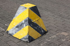 Roadside warning sign / warning stump. Traffic warning apparatus painted with black & yellow stripes Royalty Free Stock Images