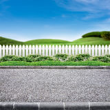 Roadside and white fence. Roadside view and white fence on green lanscape background stock images