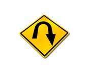 Roadsign amarillo del giro de 180 grados del diamante Fotos de archivo libres de regalías