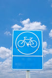 Roadsign bicycle under cloudy sky Stock Photo