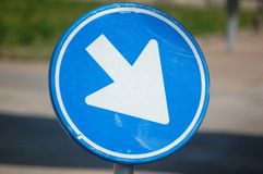 Roadsign. Blue with white arrow Royalty Free Stock Photography