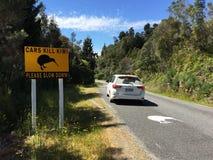 Roadsign Okarito Kiwi near Okarito, South Island, New Zealand. On the road towards Okarito (South Island, New Zealand) big road signs next to the road have been stock photography