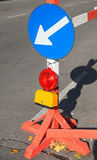 Roadsign with red light and white arrow in blue circle Royalty Free Stock Image