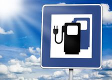 Roadsign with sky and sun with charging  station stock image