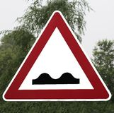 Roadsign uneven roadway Royalty Free Stock Image