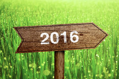 2016 roadsign. Year 2016 wooden roadsign with beautiful natural background Stock Images