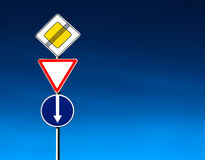 Roadsigns. Choose! Conceptual roadsign at dramatic light royalty free stock photography