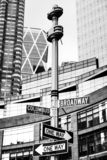 Roadsigns at the corner of Broadway and Columbus circle. NEW YORK, USA - May 01, 2016: Black and white image of street signs for Broadway and Columbus Circle stock photos