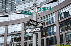 Roadsigns at the corner of Broadway and Columbus circle. NEW YORK, USA - May 01, 2016: Street signs for Broadway and Columbus Circle, Manhattan, NYC royalty free stock photo