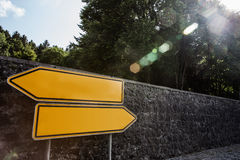 Roadsigns in different directions. Blank roadsigns showing into different directions royalty free stock photo