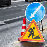 Roadsigns. Men at work, Road under construction. Roadsigns on the urban asphalt road. Men at work, square composition stock photos