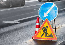 Roadsigns on the urban asphalt road Stock Image