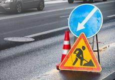 Roadsigns on the urban asphalt road. Men at work stock image