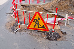 Roadsigns on the urban asphalt road. Road works royalty free stock photos