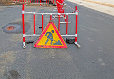 Roadsigns on the urban asphalt road. Road works royalty free stock photo