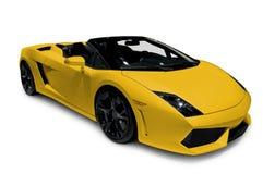 Roadster giallo con il percorso di residuo della potatura meccanica Fotografia Stock