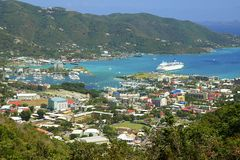 Roadtown in Tortola with a cruise ship in port. Panorama of Roadtown and a cruise ship in Tortola, Caribbean, BVI stock photography