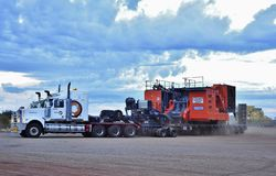 Roadtrains on the move at dawn, on the North West Highway. stock image