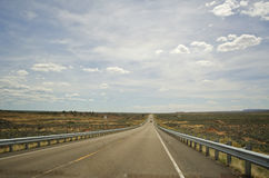 Roadtrip Arizona. A shot looking down the road of large open space in Arizona, USA Stock Images