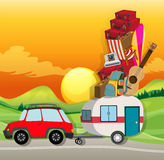 Roadtrip with car loaded with luggages Stock Images