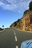 Roadtrip in La Gomera Spain. Road trip in the hills of La Gomera. Along the curvy road to Hermigua. Just the blue car the road and you in the summer holidays stock photo
