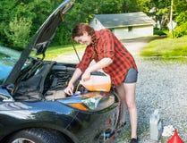 Roadtrip preparation adding windshield washer fluid Stock Photo