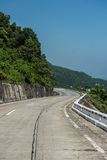 Roadtrip on a Sunny Day. Highway enroute Kim Lien in Vietnam. The mountainous road has some jaw-dropping beauty and offers smooth ride to famous Kim Lien village Royalty Free Stock Photography