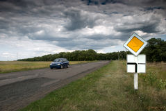 Roadway. Sign with a view of a car on the road Stock Image