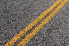 Roadway. Asphalt concrete roadway pavement surface. Grey background with yellow line royalty free stock photo